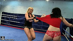 Two curvy bitches fight each other as they strip in the ring