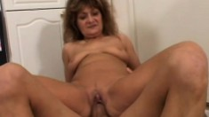 A feisty MILF is on the hunt for hung young men to bone her twat
