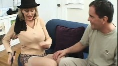 A big breasted MILF gets showered in cum in a brutal fuckfest