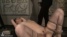 Bound babe gets an orgasm from a dildo and a powerful vibrator