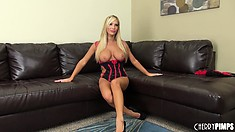 Tasha Reign poses in pink outfit and pushes her tits out of tight bra