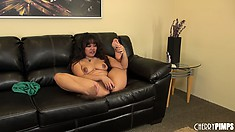 Annie lies on the couch rubbing her slit and spreads her legs wide