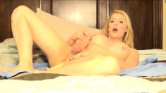 Pretty blonde tranny with big boobs stuffs a dildo deep inside her ass