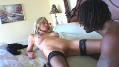 Hung black stud gives a stacked blonde mom a deep pounding on the bed