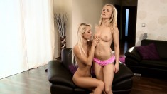 Fascinating blondes with sexy slender bodies indulge in lesbian action