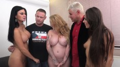 Three slutty girls with big hooters share a long dick and a fresh load