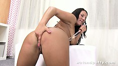 Now her clit is erect and she shoves a big toy in her cunt and a fingers in her ass