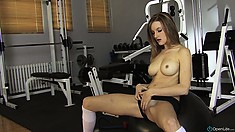 Sporty babe Ashley Hills pulls aside her black panties and rubs clit
