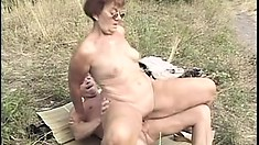 Naughty grandma takes a big hard dicking out in an open field