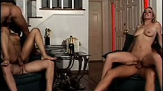 A pair of attractive blondes play with each other and three rods