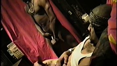 Two black studs with hot bodies stroke their huge cocks until they cum