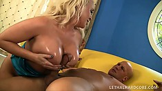 Buxom blonde with a superb ass rides a stiff cock until her pussy gets creampied