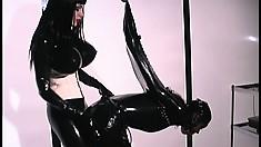 Anastasia Pierce paddles her rubber covered slave and gasmasks her