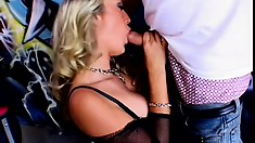Well-endowed blond slut in fishnet tights going crazy on a meaty cock
