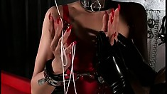 Brunette mistress enjoys her slaves' bodies in their latex suits