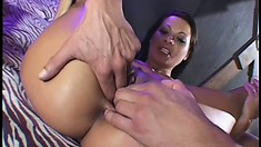 Skinny brunette slut gets double teamed by a pair of massive cocks