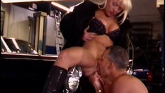 Hot blonde in black boots Sandra gets fucked by a mechanic in the garage