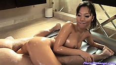 Asian babe Asa Akira sucking a guy's cock after a slutty nuru massage
