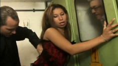 Ethnic hottie in black stockings has two horny guys punishing her holes