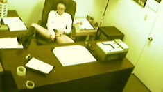 Naughty secretary gets caught on camera getting off at the office