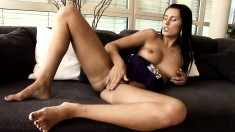 Stacked brunette with a heavenly ass vigorously fingers her honey hole