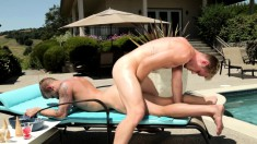 Tattooed hunk gets his ass pounded hard by his gay lover under the sun