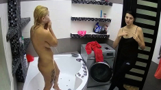 Busty brunette takes a shower with water on boobs