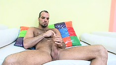 Hairy guy with a great body Jerald strokes his big cock to pleasure