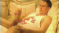 Cody James lies comfortably on the couch and strokes his long dick