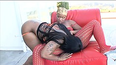 Busty lesbian can't resist her lover's pussy peeking out of a bodystocking