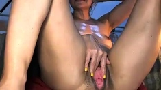 Solo slut shoves toys in ass and pussy close up