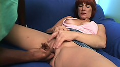Naughty redhead bends over to take a hung black guy's meaty dick