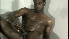 Black strongman spreads his cheeks to reveal a tight hole as he wanks
