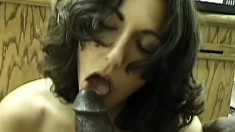 Luscious brunette drops to her knees and worships a huge black stick