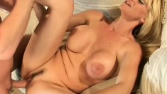 Big breasted blonde milf gets her fiery pussy pounded deep on the sofa